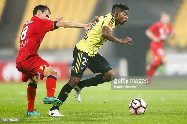 Roy Krishna of the Phoenix beats the challenge of Isaias of Adelaide United during the round 13 ALeague match between Wellington Phoenix and Adelaide...
