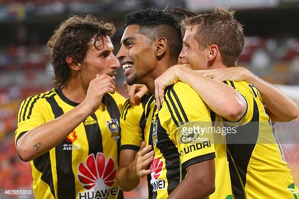 Roy Krishna of the Phoenix celebrates with team mates after scoring a goal during the round 16 ALeague match between the Brisbane Roar and the...