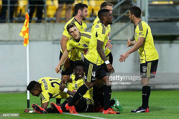 Roy Krishna of the Phoenix celebrates with teammates after scoring a goal during the round three ALeague match between the Wellington Phoenix and the...