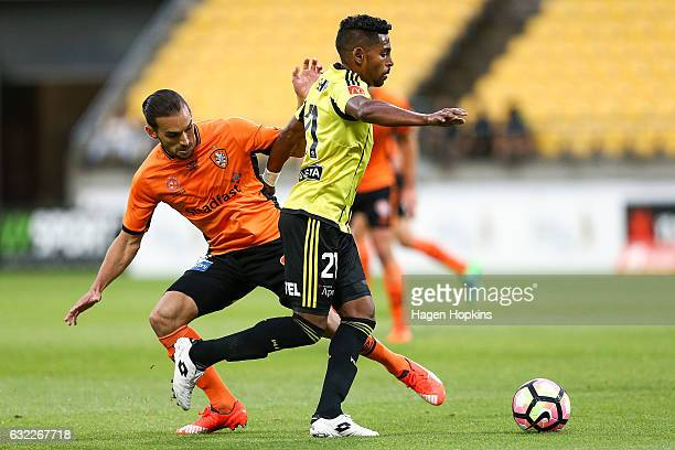 Roy Krishna of the Phoenix is challenged by Jack Hingert of the Roar during the round 16 ALeague match between the Wellington Phoenix and the...