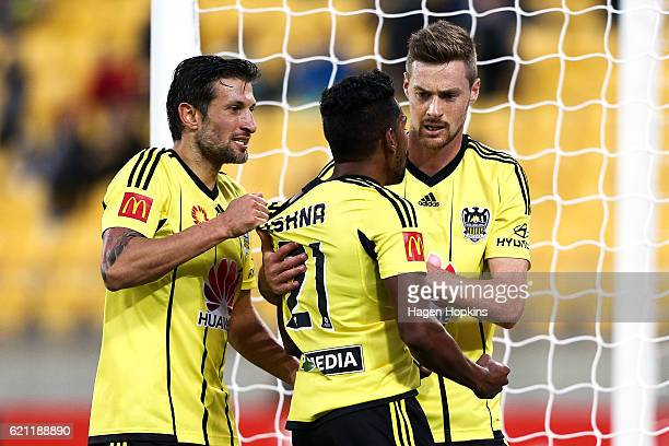 Roy Krishna of the Phoenix is congratulated on his goal by teammates Vince Lia and Jacob Tratt during the round five ALeague match between the...