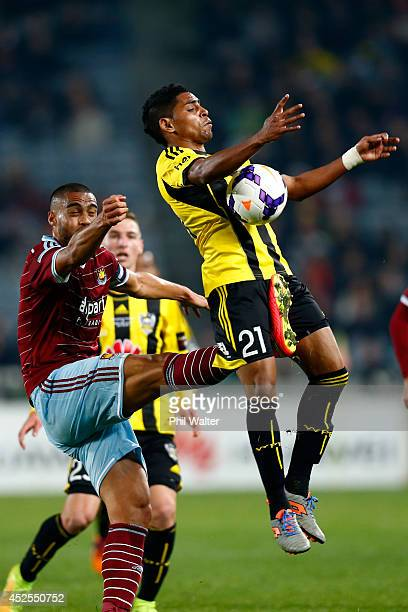Roy Krishna of the Phoenix is kicked by Winston Reid of West Ham during the Football United New Zealand Tour match between the Wellington Phoenix and...