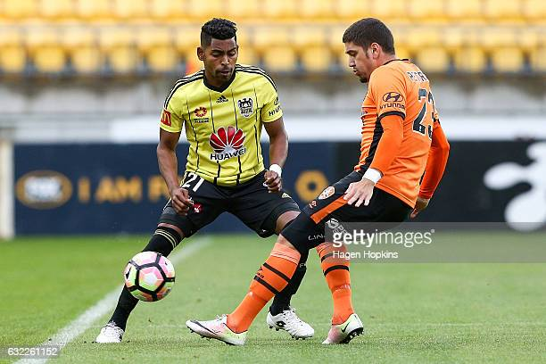 Roy Krishna of the Phoenix is tackled by Dimitri Petratos of the Roar during the round 16 ALeague match between the Wellington Phoenix and the...