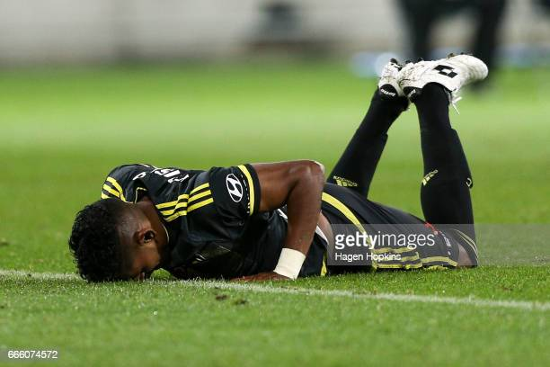 Roy Krishna of the Phoenix lies on the ground after being brought down in a tackle during the round 26 ALeague match between the Wellington Phoenix...