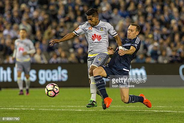 Roy Krishna of the Wellington Phoenix and Alan Baro of Melbourne Victory contest the ball during the 4th round of the Hyundai ALeague between...
