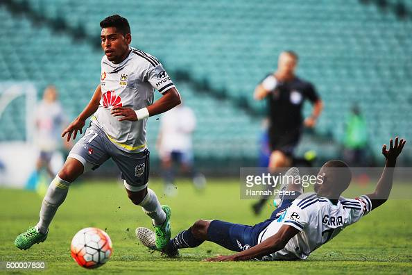 Roy Krishna of the Wellington Phoenix gets past Jason Geria of the Melbourne Victory during the round nine ALeague match between the Wellington...