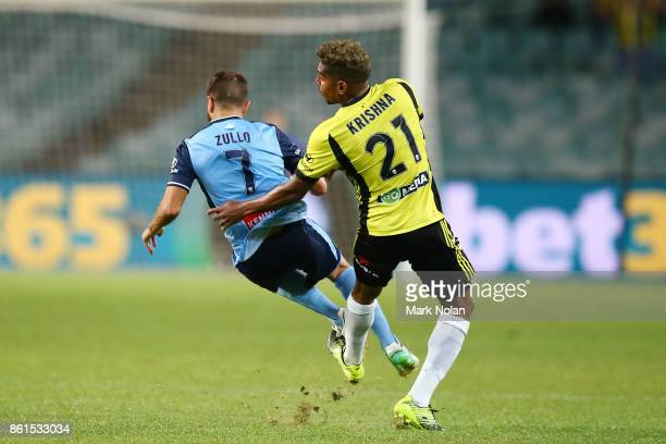 Roy Krishna of Wellington fouls Michael Zullo of Sydney during the round two ALeague match between Sydney FC and the Wellington Phoenix at Allianz...