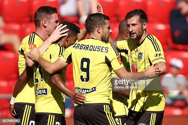 Roy Krishna of Wellington Phoenix celebrates with teammates after scoring a goal during the round 17 ALeague match between Adelaide United and the...