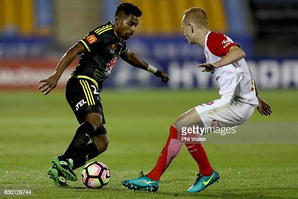 Roy Krishna of Wellington takes the ball to Jack Clisby of Western Sydney during the round 11 ALeague match between the Wellington Phoenix and...
