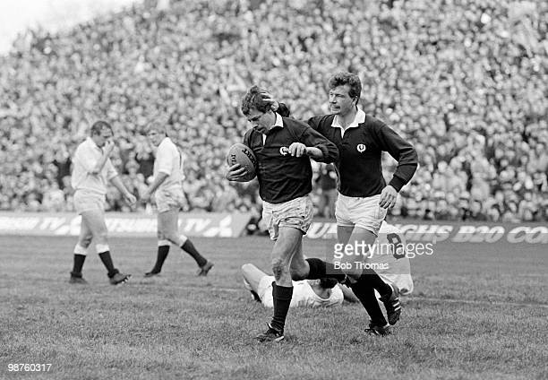 Roy Laidlaw of Scotland is congratulated by teammate Jim Pollock after scoring a try against England during the Rugby Union International Calcutta...