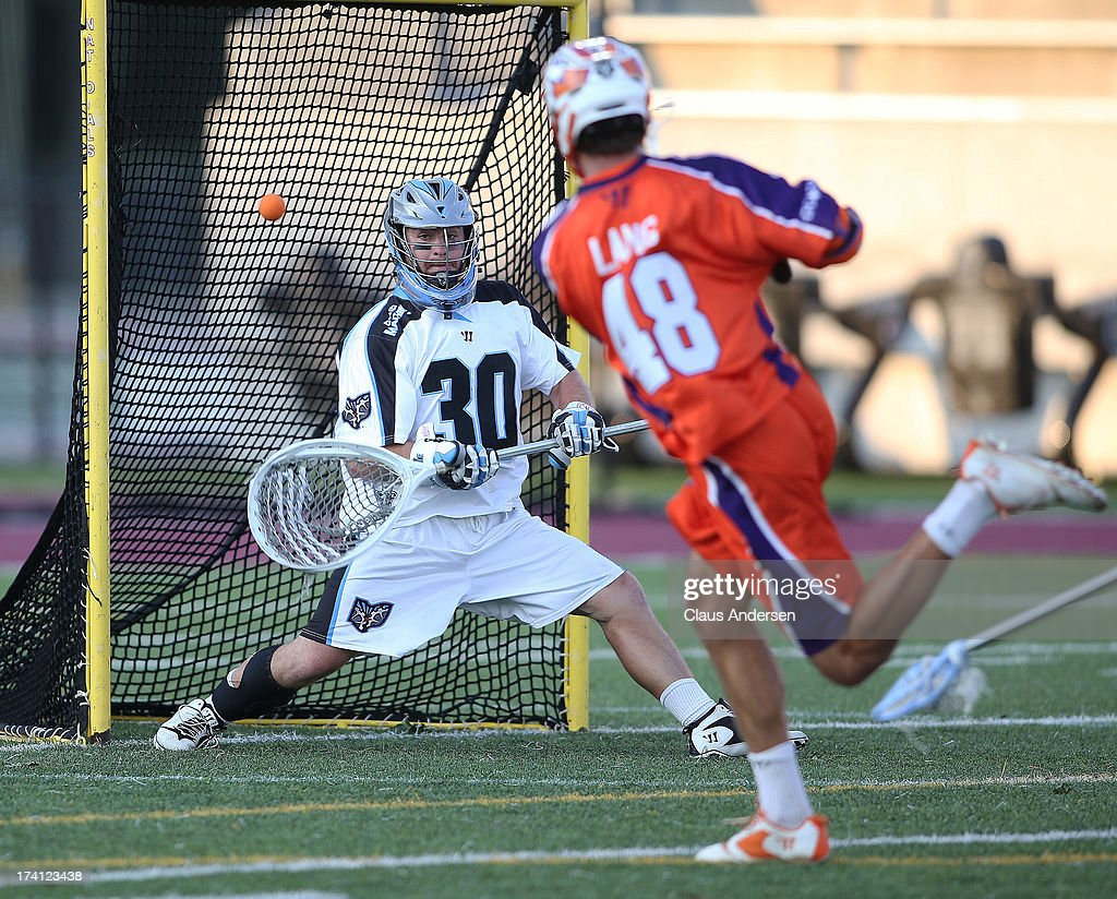 Roy Lang #48 of the Hamilton Nationals fires a shot past Brian Phipps #30 of the Ohio Machine in a Major League Lacrosse game on July 20, 2013 at Ron Joyce Stadium in Hamilton, Ontario, Canada.