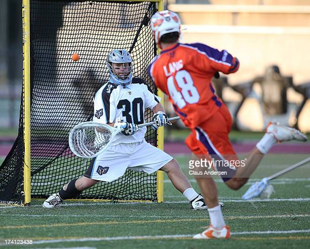 Roy Lang of the Hamilton Nationals fires a shot past Brian Phipps of the Ohio Machine in a Major League Lacrosse game on July 20 2013 at Ron Joyce...