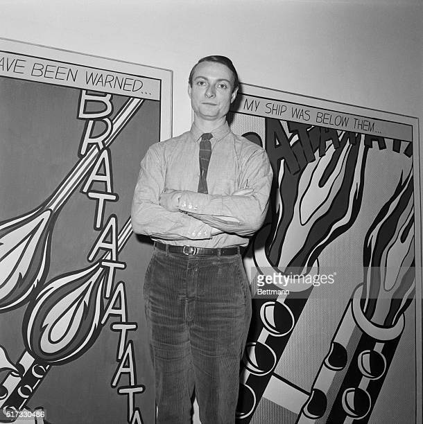 Roy Lichtenstein stands in front of his comic strip inspired work which has caption 'As I opened fire I knew why Tex had not buzzed me If he had The...