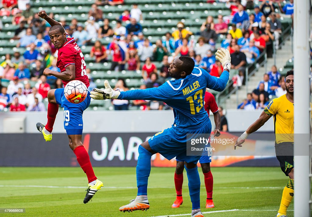 Roy Miller #19 of Costa Rica scores a goal as Dwayne Miller #13 of Jamaica attempt to stop the ball during the 2015 CONCACAF Gold Cup Group B match between Costa Rica and Jamaica at the StubHub Center on July 8, 2015 in Carson, California. The match ended in a 2-2 draw.