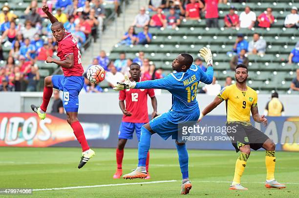 Roy Miller of Costa Rica watches his header beat Jamaica goalkeeper Dwayne Miller for a first half equalizer during their 2015 Concacaf Gold Cup...
