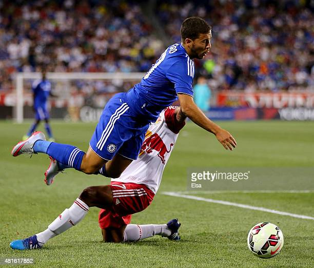 Roy Miller of New York Red Bulls and Eden Hazard of Chelsea collide in the second half during the International Champions Cup at Red Bull Arena on...