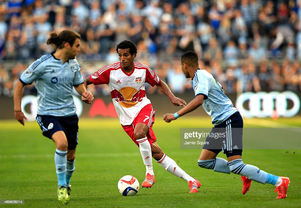 Roy Miller #7 of New York Red Bulls controls the ball as Graham Zusi #8 and Amadou Dia #13 of Sporting KC defend during the game at Sporting Park on March 8, 2015 in Kansas City, Kansas.