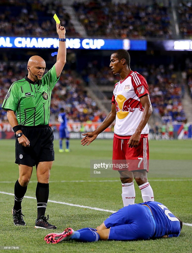 Roy Miller #7 of New York Red Bulls is given a yellow card after his collision with Eden Hazard #10 of Chelsea in the second half during the International Champions Cup at Red Bull Arena on July 22, 2015 in Harrison, New Jersey.The New York Red Bulls defeated Chelsea 4-2.