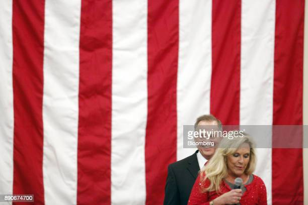 Roy Moore Republican candidate for US Senate from Alabama reacts as his wife Kayla Moore speaks during a campaign rally in Midland City Alabama US on...