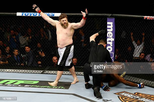 Roy Nelson celebrates his win by knockout against Cheick Kongo of France in their heavyweight bout during the UFC 159 event at the Prudential Center...