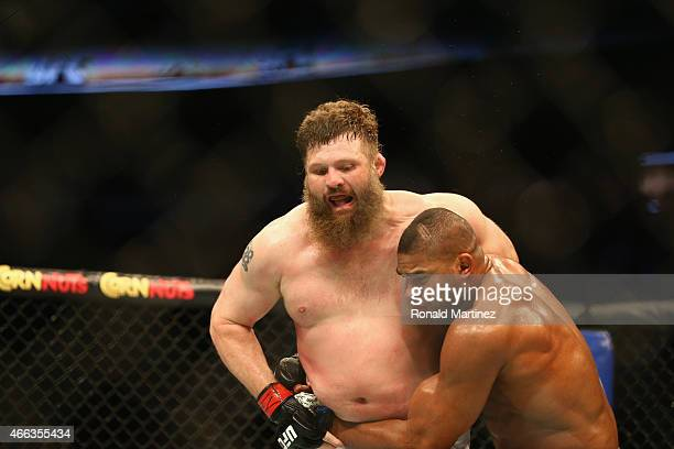 Roy Nelson fights with Alistair Overeem in the Heavyweight bout during the UFC 185 event at American Airlines Center on March 14 2015 in Dallas Texas
