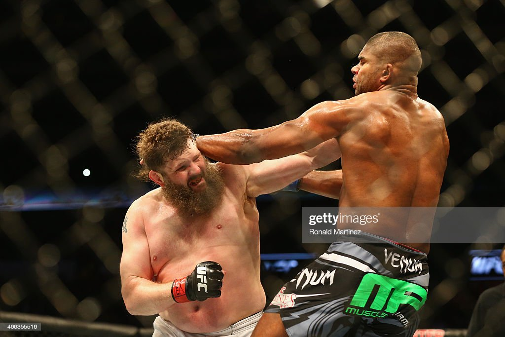 <a gi-track='captionPersonalityLinkClicked' href=/galleries/search?phrase=Roy+Nelson&family=editorial&specificpeople=4230645 ng-click='$event.stopPropagation()'>Roy Nelson</a> fights with <a gi-track='captionPersonalityLinkClicked' href=/galleries/search?phrase=Alistair+Overeem&family=editorial&specificpeople=7480034 ng-click='$event.stopPropagation()'>Alistair Overeem</a> in the Heavyweight bout during the UFC 185 event at American Airlines Center on March 14, 2015 in Dallas, Texas.