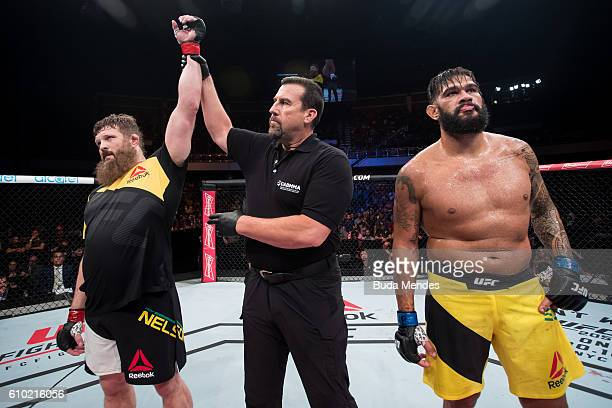Roy Nelson of the United States celebrates victory over Antonio Silva of Brazil in their heavyweight UFC bout during the UFC Fight Night event at...