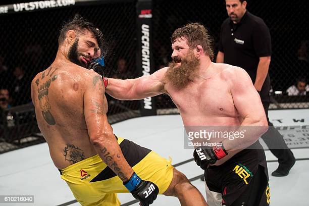 Roy Nelson of the United States punches Antonio Silva of Brazil in their heavyweight UFC bout during the UFC Fight Night event at Nilson Nelson...