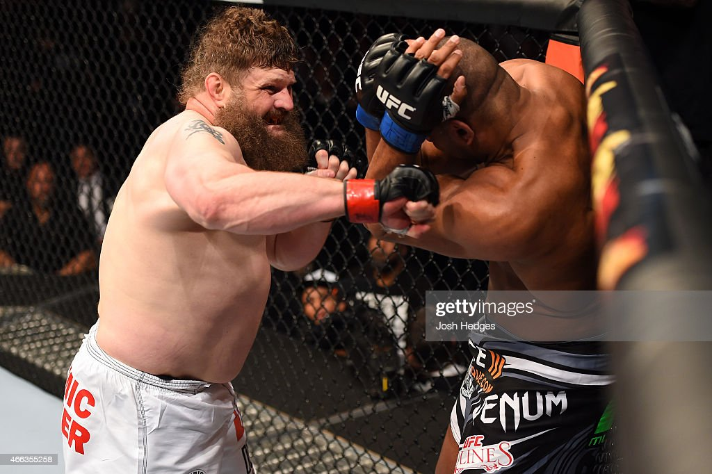 Roy Nelson punches Alistair Overeem in their heavyweight bout during the UFC 185 event at the American Airlines Center on March 14 2015 in Dallas...