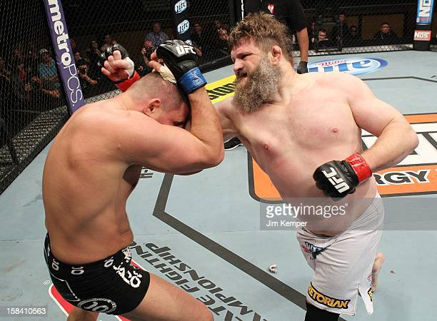 Roy Nelson punches Matt Mitrione during their heavyweight fight at the TUF 16 Finale on December 15 2012 at the Joint at the Hard Rock in Las Vegas...