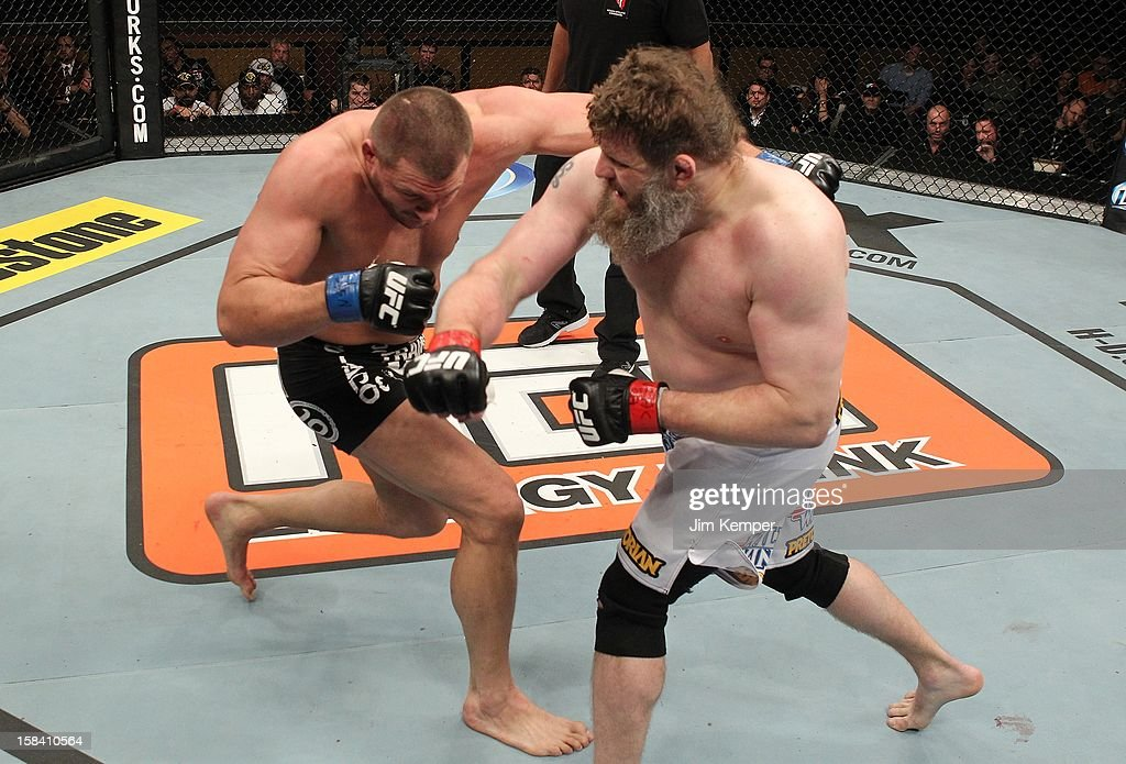 <a gi-track='captionPersonalityLinkClicked' href=/galleries/search?phrase=Roy+Nelson&family=editorial&specificpeople=4230645 ng-click='$event.stopPropagation()'>Roy Nelson</a> punches Matt Mitrione during their heavyweight fight at the TUF 16 Finale on December 15, 2012 at the Joint at the Hard Rock in Las Vegas, Nevada.