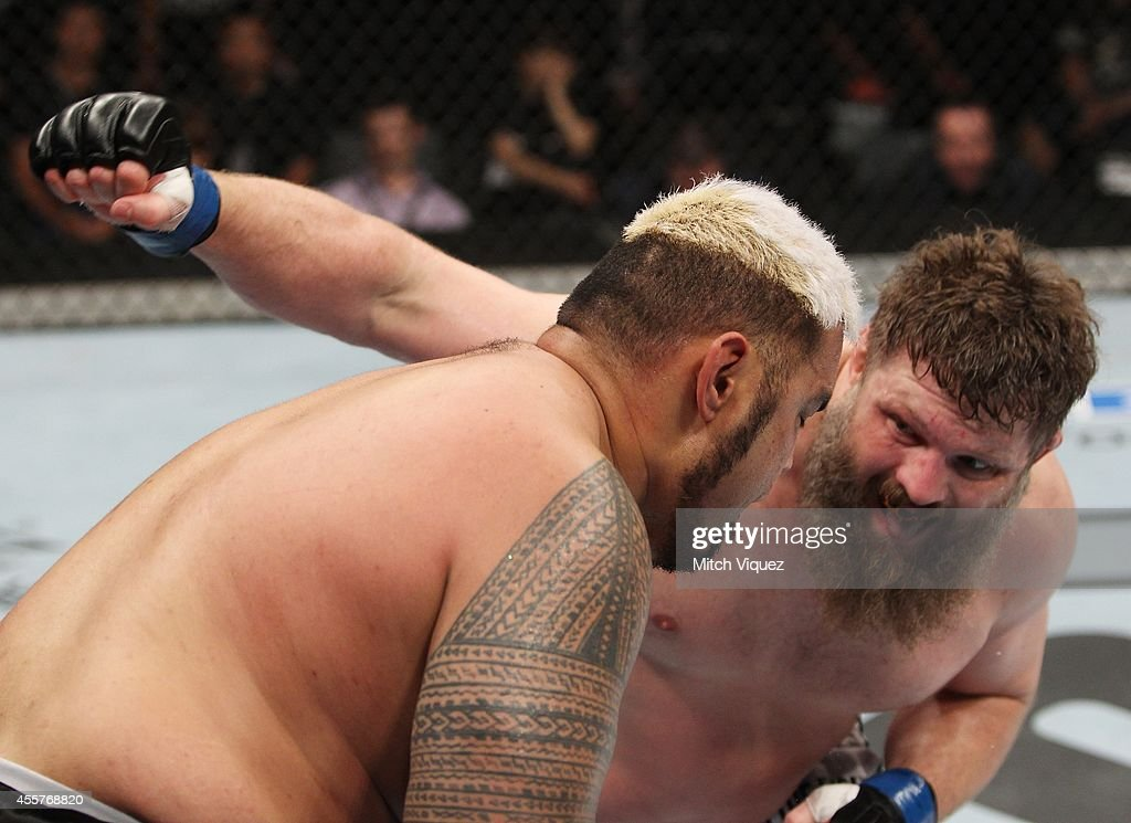 Roy Nelson throws a punch at Mark Hunt in their heavyweight bout during the UFC Fight Night event inside the Saitama Arena on September 20 2014 in...