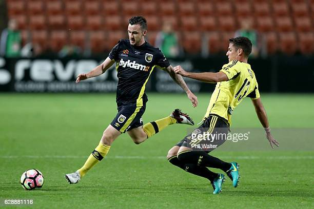 Roy O'Donovan of Central Coast is tackled by Marco Rossi of Wellington during the round 10 ALeague match between the Wellington Phoenix and the...