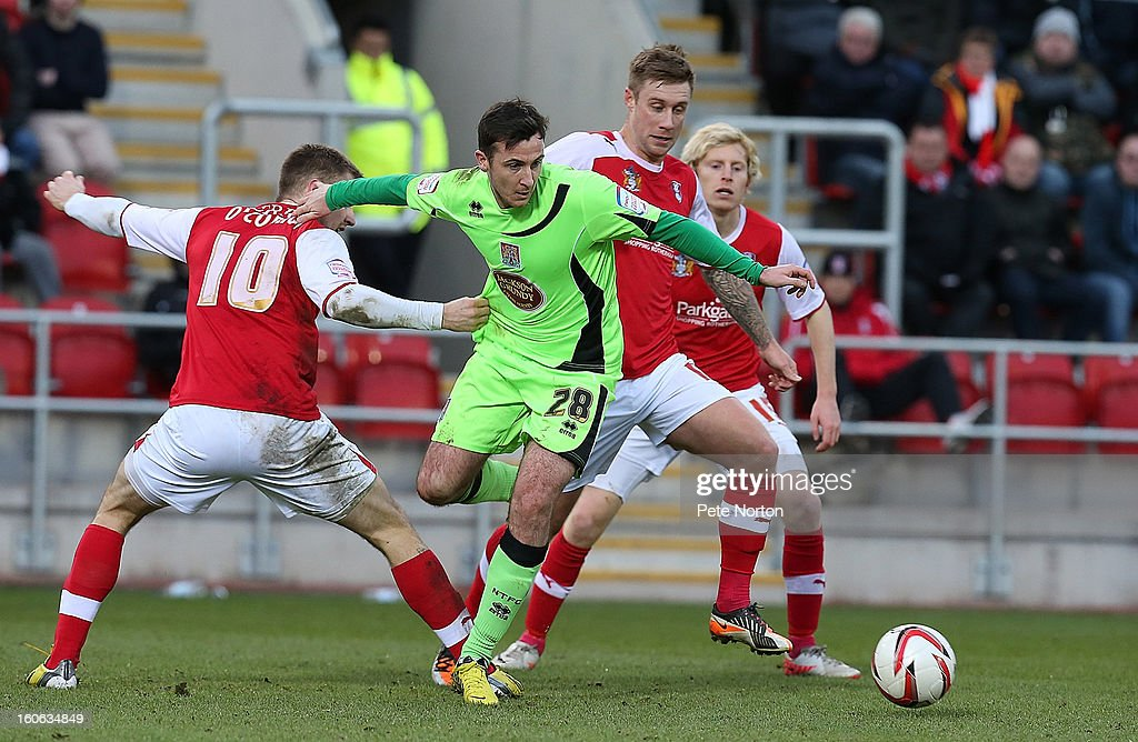 Roy O'Donovan (C) of Northampton Town attempts to move with the ball between Michael O'Connor (l) and David Noble of Rotherham United during the npower League Two match between Rotherham United and Northampton Town at New York Stadium on February 2, 2013 in Rotherham, England.