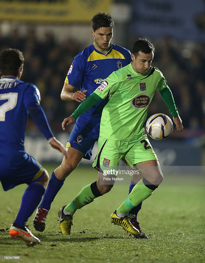 Roy O'Donovan of Northampton Town looks to control the ball watched by Pim Balkestein of AFC Wimbledon during the npower League Two match between AFC Wimbledon and Northampton Town at The Cherry Red Records Stadium on February 19, 2013 in Kingston upon Thames, England.