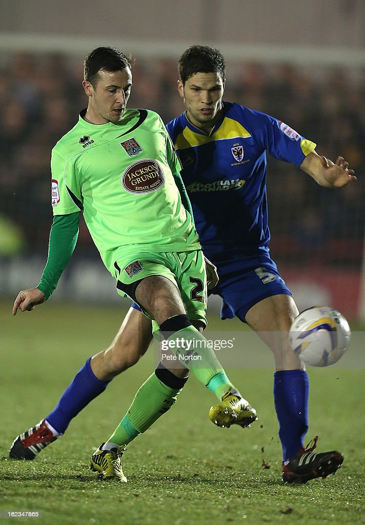 Roy O'Donovan of Northampton Town plays the ball watched by Pim Balkestein of AFC Wimbledon during the npower League Two match between AFC Wimbledon and Northampton Town at The Cherry Red Records Stadium on February 19, 2013 in Kingston upon Thames, England.