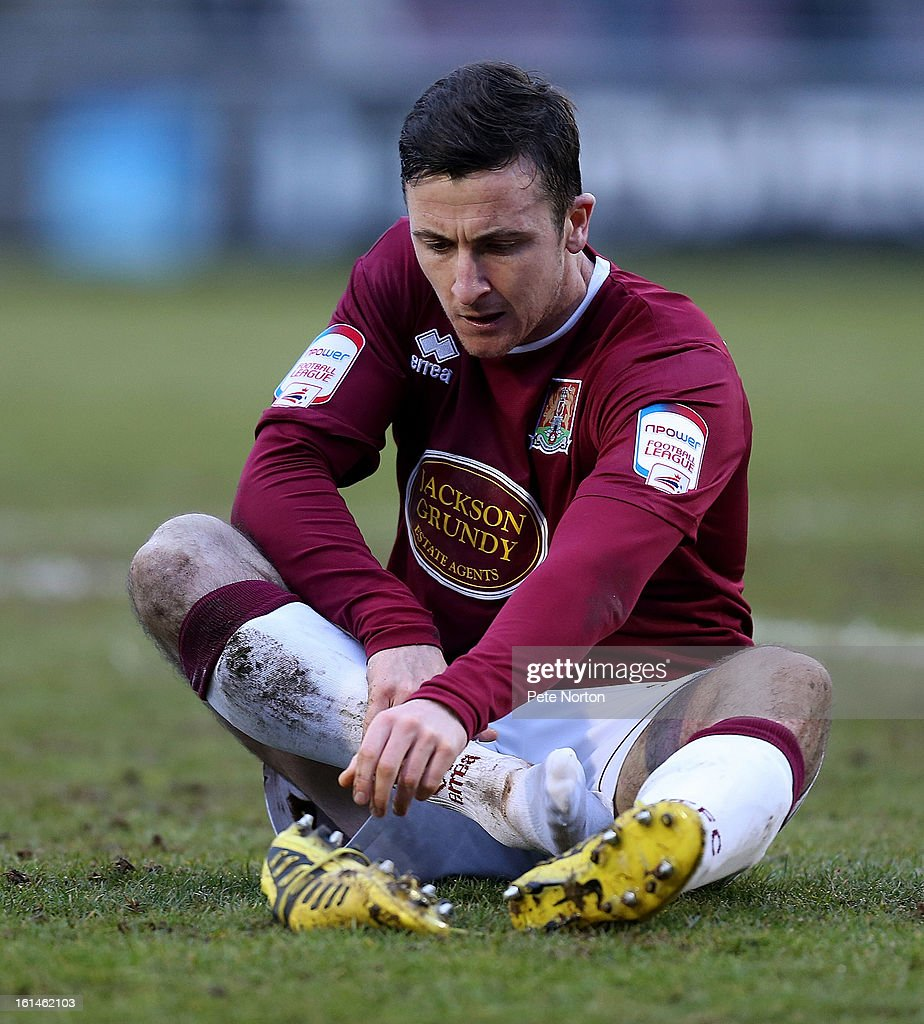 Roy O'Donovan of Northampton Town replaces his boot during the npower League Two match between Northampton Town and Rochdale at Sixfields Stadium on February 9, 2013 in Northampton, England.