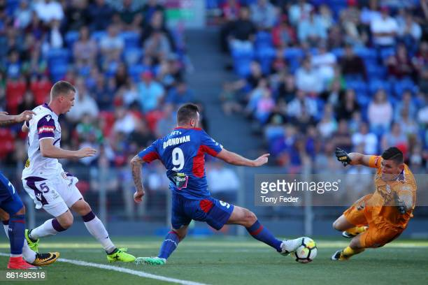 Roy O'Donovan of the Jets beats Glory goalkeeper Liam Reddy to score a goal during the round two ALeague match between the Newcastle Jets and the...