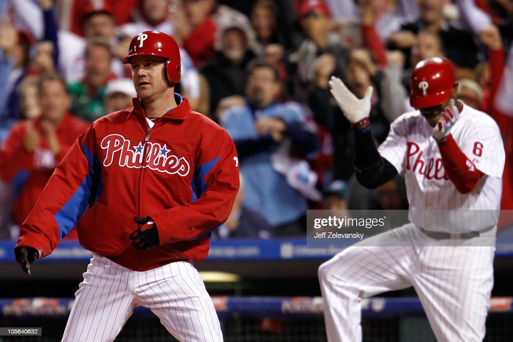 <a gi-track='captionPersonalityLinkClicked' href=/galleries/search?phrase=Roy+Oswalt&family=editorial&specificpeople=171836 ng-click='$event.stopPropagation()'>Roy Oswalt</a> #44 of the Philadelphia Phillies reacts as does teammate <a gi-track='captionPersonalityLinkClicked' href=/galleries/search?phrase=Ryan+Howard&family=editorial&specificpeople=551402 ng-click='$event.stopPropagation()'>Ryan Howard</a> #6 after Oswalt slides home safely before the tag of Buster Posey #28 of the San Francisco Giants in the seventh inning to score a run in Game Two of the NLCS during the 2010 MLB Playoffs at Citizens Bank Park on October 17, 2010 in Philadelphia, Pennsylvania.