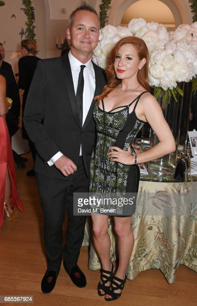 Roy Price and Lila Feinberg attend The 9th Annual Filmmakers Dinner hosted by Charles Finch and JaegerLeCoultre at Hotel du CapEdenRoc on May 19 2017...