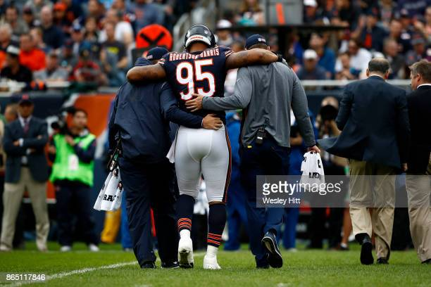 Roy RobertsonHarris of the Chicago Bears is helped off of the field in the second quarter against the Carolina Panthers at Soldier Field on October...
