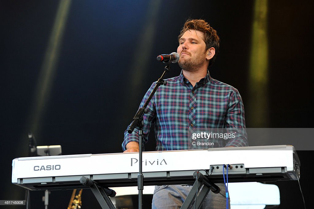 <a gi-track='captionPersonalityLinkClicked' href=/galleries/search?phrase=Roy+Stride&family=editorial&specificpeople=4500346 ng-click='$event.stopPropagation()'>Roy Stride</a> of Scouting For Girls performs on stage at the Cornbury Music Festival at Great Tew Estate on July 5, 2014 in Oxford, United Kingdom.