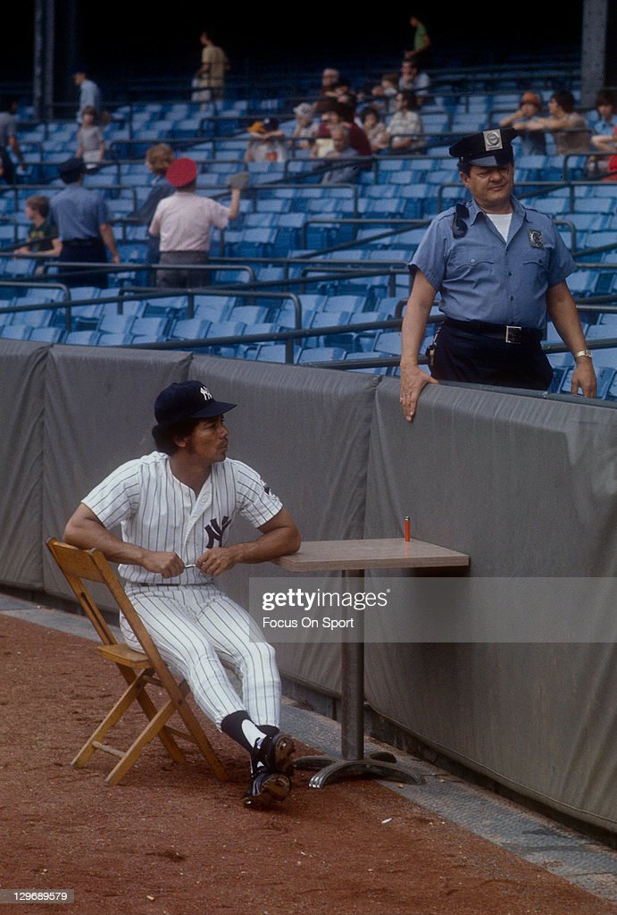 Roy White #6 of the New York Yankees sits at a table waiting to sign autographs for fans before an MLB baseball game circa 1975 at Yankee Stadium in the Bronx borough of New York City. White played for the Yankees from 1965-79.