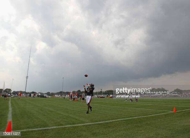 Roy Williams of the Chicago Bears catches a pass during a summer training camp practice at Olivet Nazarene University on August 6 2011 in Bourbonnais...