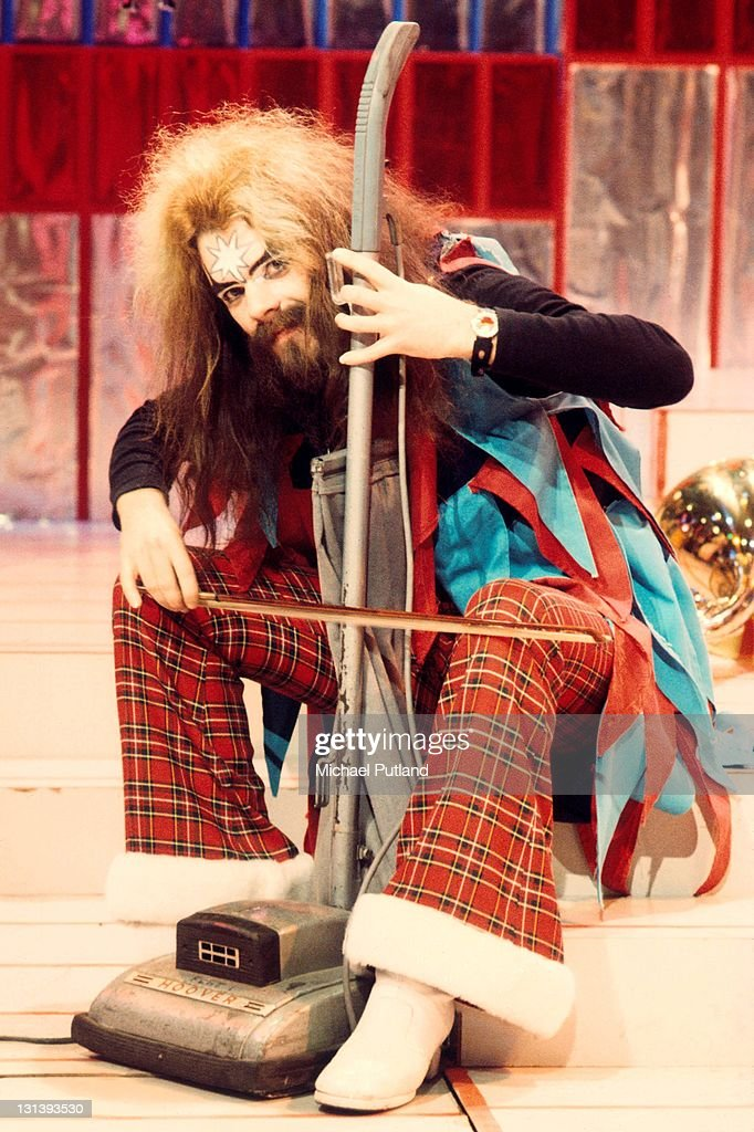 Roy Wood of Wizzard playing a Hoover vacuum cleaner with a violin bow on the set of BBC TV show Top Of The Pops, London, 1974.