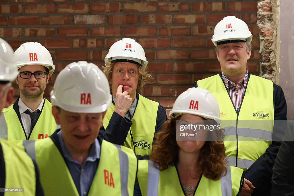 Royal Academician Grayson Perry (C) and Royal Academy Trustee Stephen Fry (R) attend the Topping Out Ceremony for Keeper's House at the Royal Academy of Arts on April 25, 2013 in London, England. Key Royal Academy of Arts' personnel are celebrating the architectural milestone in the redevelopment of Keeper's House; a major project to transform facilities for visitors to the Royal Academy. The work, which opens to the public in autumn 2013, is being undertaken by architects Long & Kentish, with interior design by David Chipperfield Architects. The space includes a new restaurant, bar and walled garden.