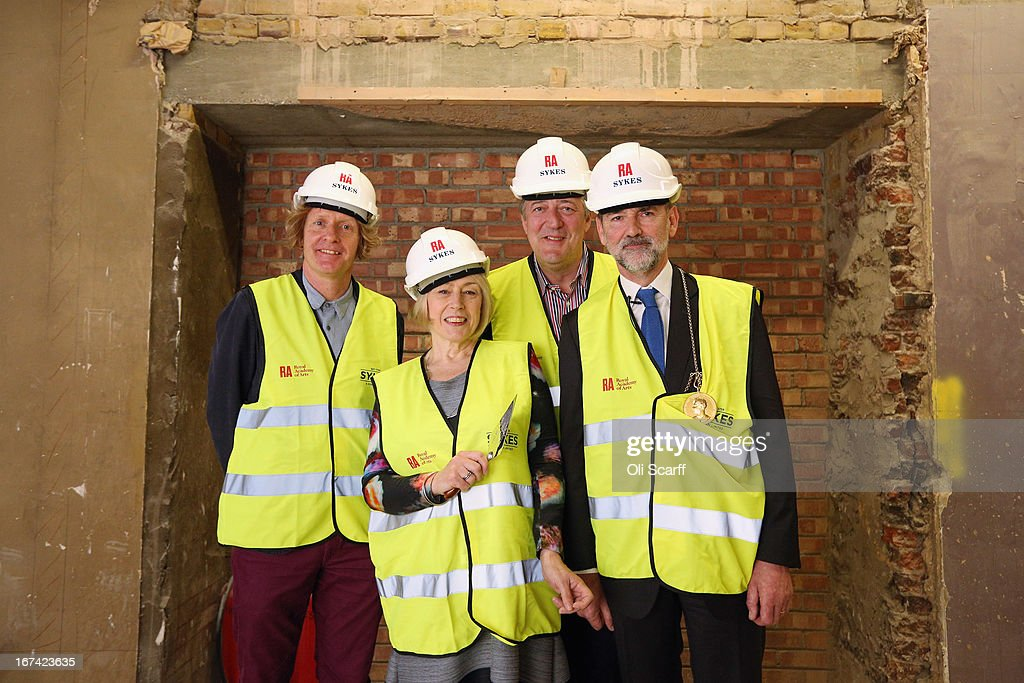 Royal Academician Grayson Perry, Keeper of the Royal Academy Schools Eileen Cooper, Royal Academy Trustee Stephen Fry and President of the Royal Academy of Arts Christopher Le Brun attend the Topping Out Ceremony for Keeper's House at the Royal Academy of Arts on April 25, 2013 in London, England. Key Royal Academy of Arts' personnel are celebrating the architectural milestone in the redevelopment of Keeper's House; a major project to transform facilities for visitors to the Royal Academy. The work, which opens to the public in autumn 2013, is being undertaken by architects Long & Kentish, with interior design by David Chipperfield Architects. The space includes a new restaurant, bar and walled garden.