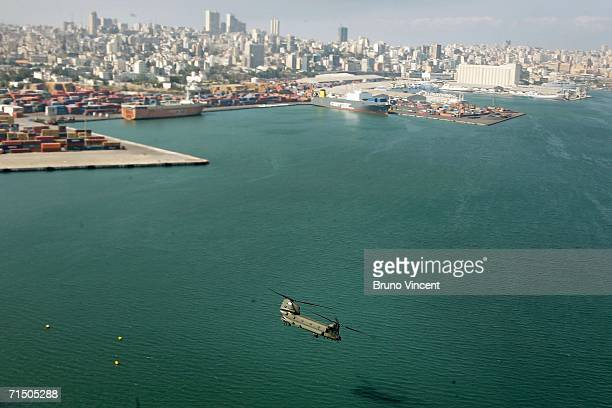 Royal Air Force Chinook helicopter flies infront of the Beirut skyline July 22 2006 Over 25000 foreigners many of whom were caught while on holiday...