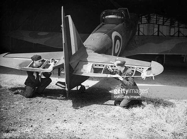 Royal Air Force Fighter Command 19391945 Riggers examining the damage to the elevators of a BoultonPaul Defiant Mark I of No 264 Squadron RAF in a...