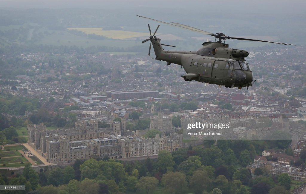 A Royal Air Force (RAF) Puma helicopter passes over Windsor Castle on May 19, 2012 in Windsor, England. As part of the Diamond Jubilee celebrations armed forces are paying tribute to Her Majesty Queen Elizabeth II in a Parade and Muster event involving 2500 troops in and around Windsor Castle. The RAF, Royal Navy and Army took part in a flypast of 78 aircraft including four Spitfires and a Lancaster bomber from The Battle of Britain Memorial Flight.